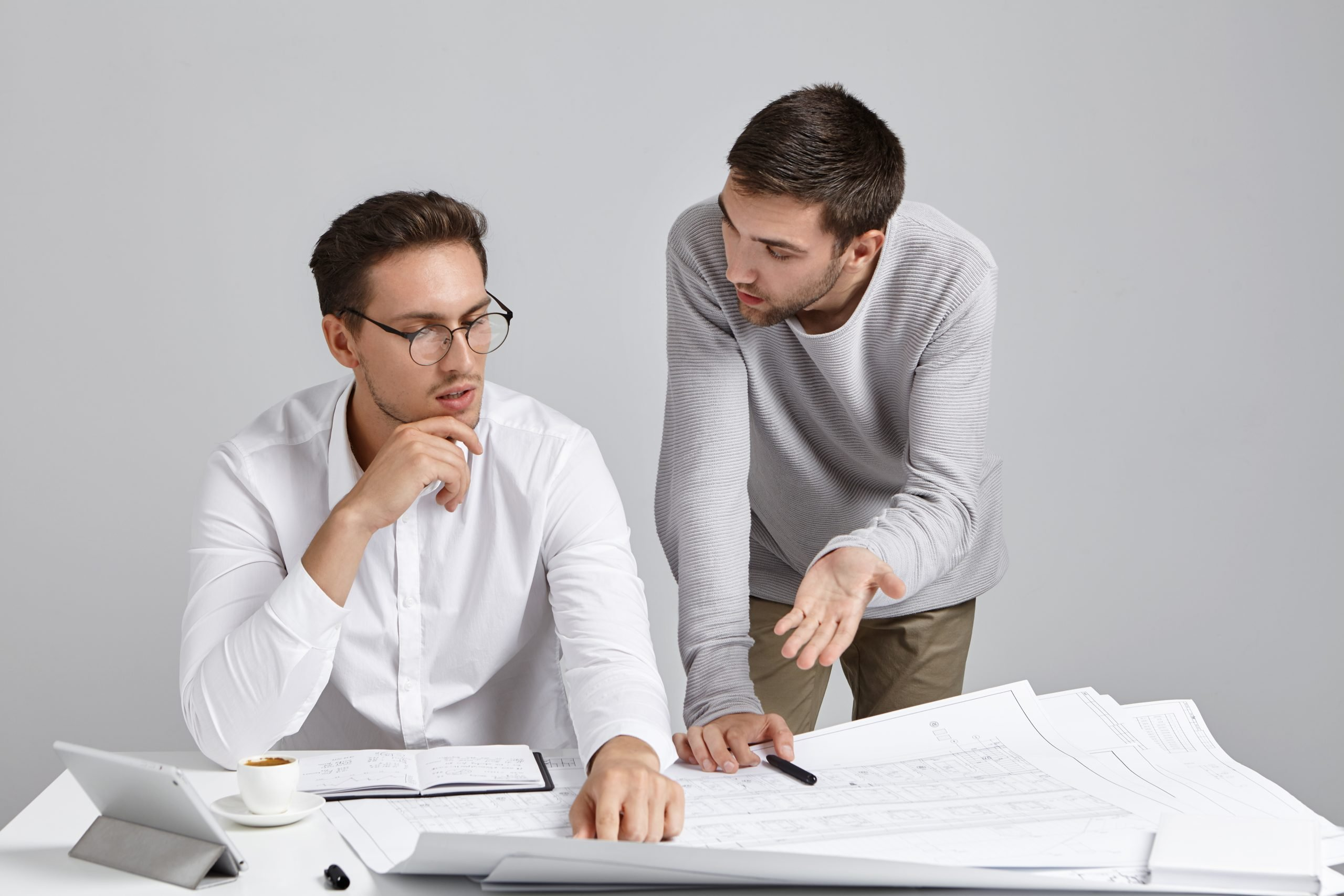 male coworkers doing paperwork